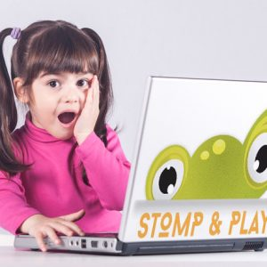 Cute little girl reacts with shock while using a laptop. Internet safety concept. Toned image with selective focus
